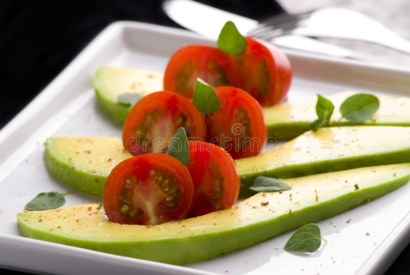 鲕梨沙拉蕃茄 库存照片