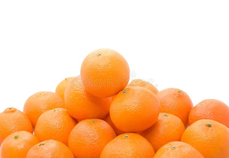 鲜美明亮的橙色堆的蜜桔 免版税库存图片