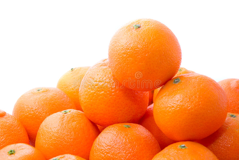 鲜美明亮的橙色堆的tangerins 免版税库存图片