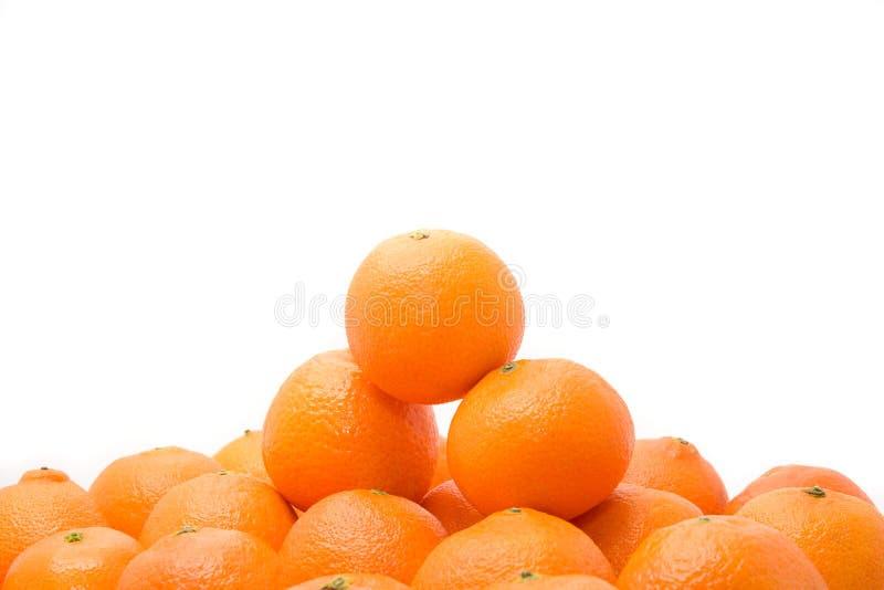 鲜美明亮的橙色堆的tangerins 库存图片