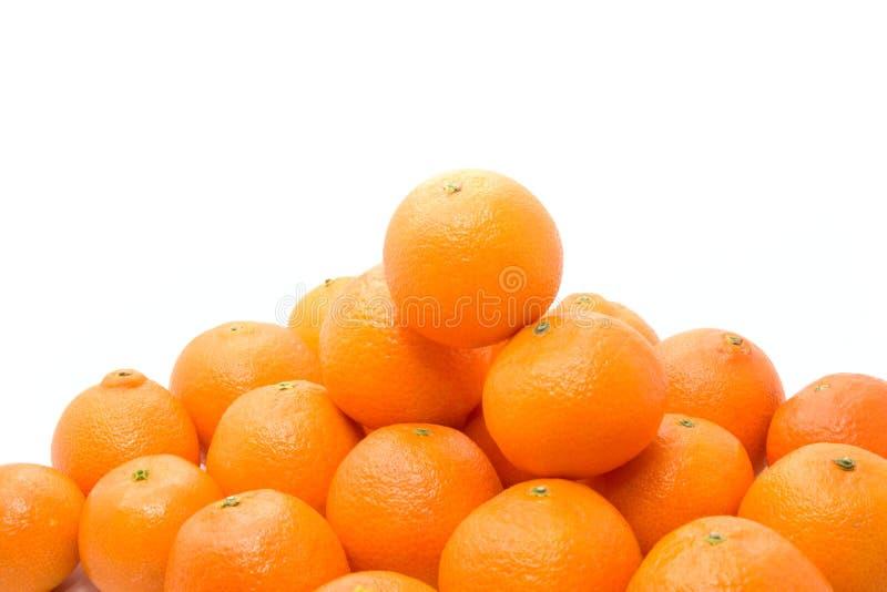 鲜美明亮的橙色堆的tangerins 免版税库存照片