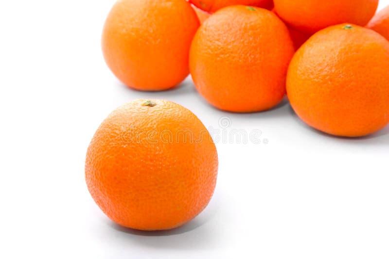 鲜美明亮的橙色的tangerins 免版税库存照片