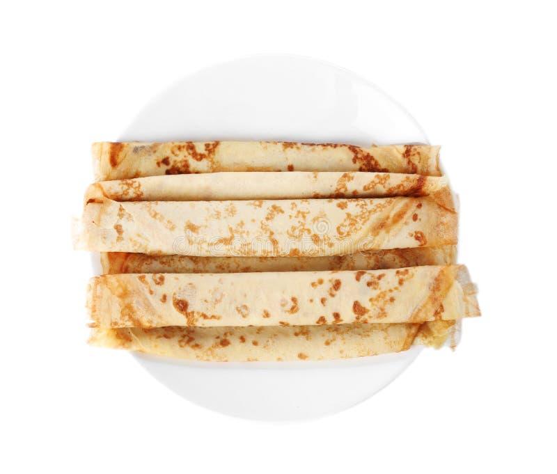 鲜美稀薄的薄煎饼在板材滚动 免版税库存图片