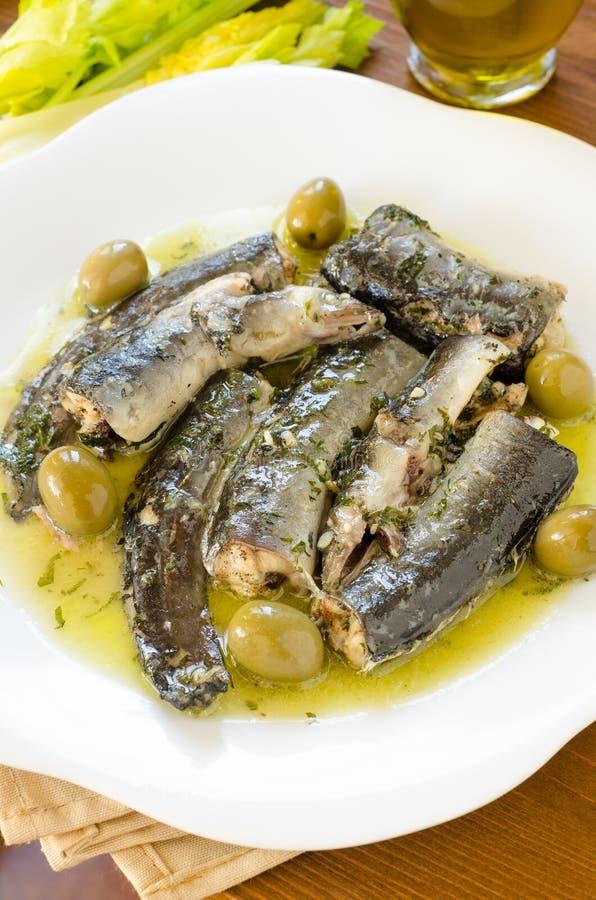 鳗鱼用橄榄色的调味汁 免版税库存照片
