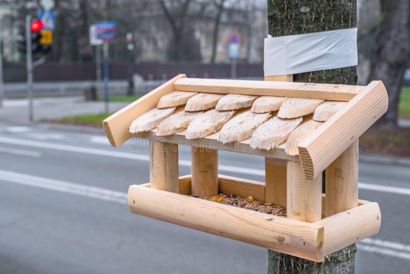 鸟饲养者在华沙在波兰 免版税库存照片