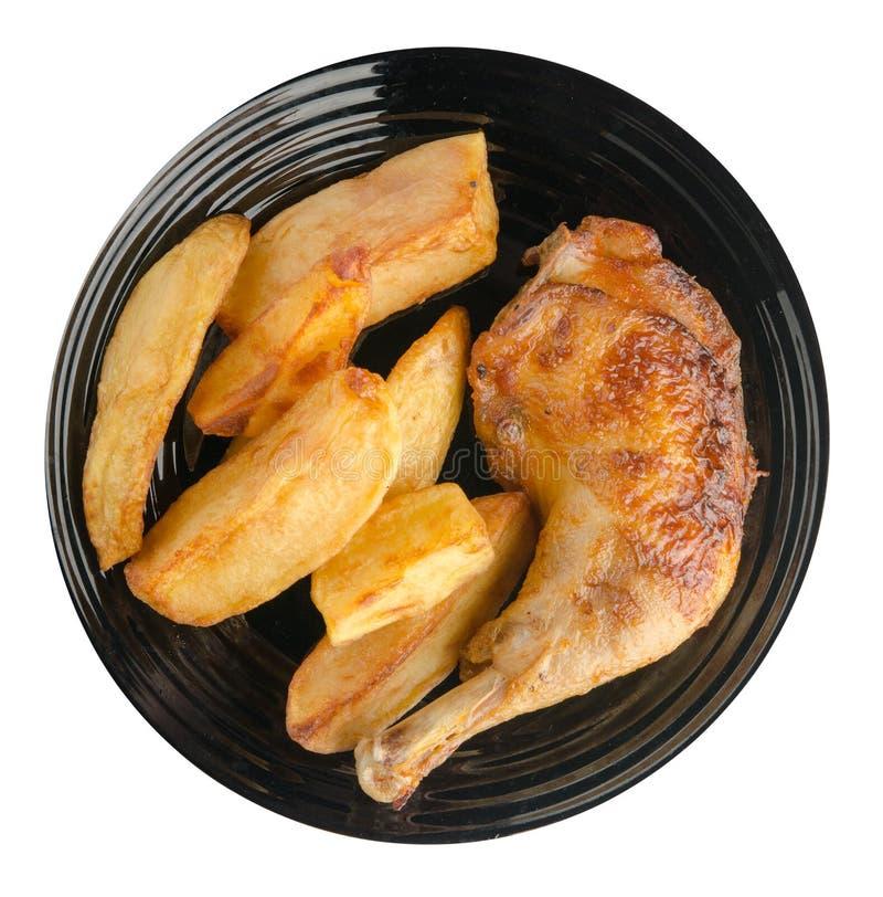 鸡大腿用在白色背景隔绝的炸薯条 库存照片