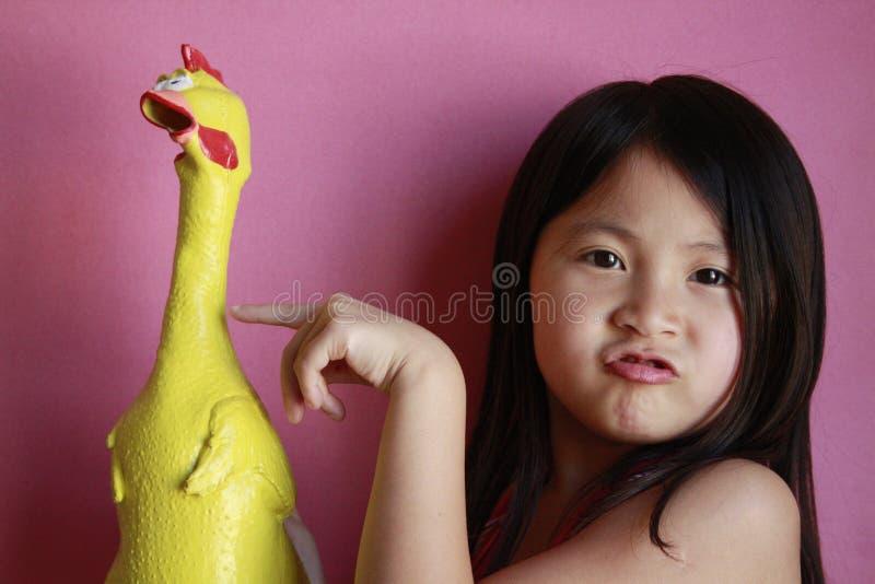 鸡女孩少许橡胶 库存照片