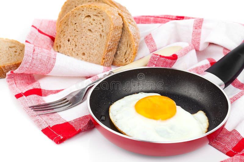 鸡蛋油煎的煎锅 免版税库存图片