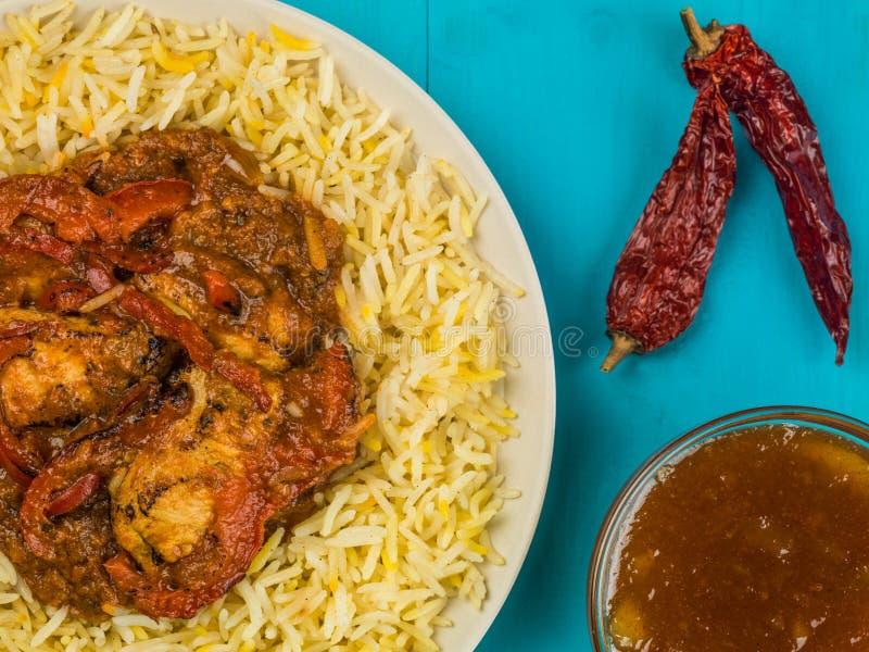 鸡Jalfrezi咖喱和Pilau米 免版税库存照片