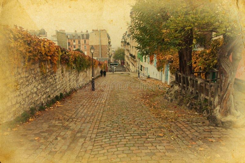 鹅卵石路在葡萄酒样式的巴黎 免版税库存照片