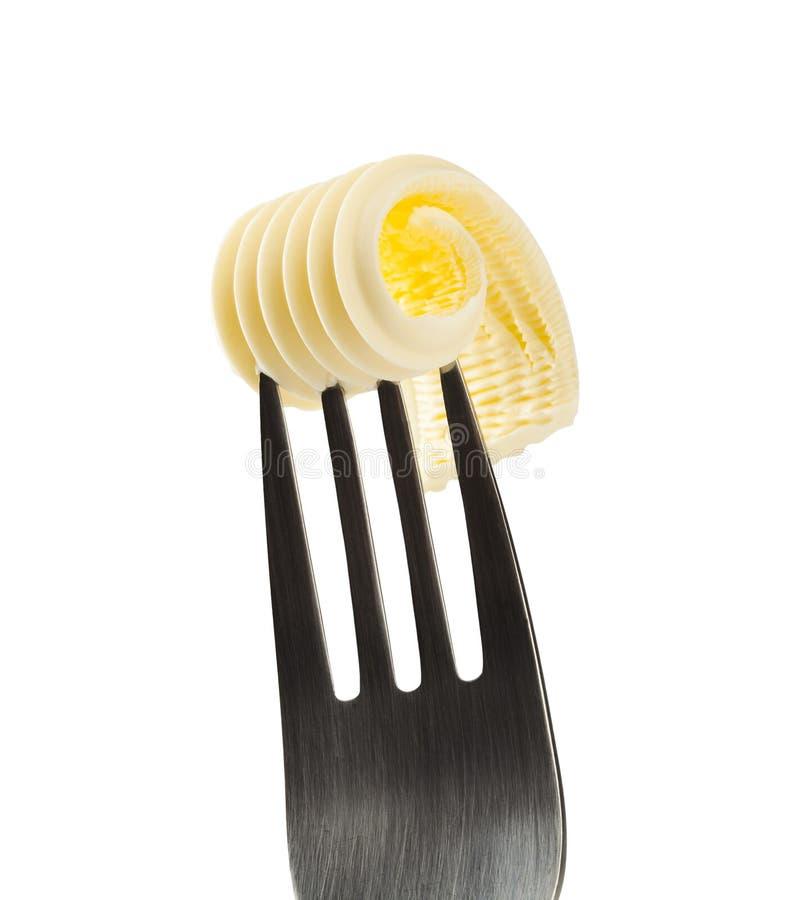 黄油卷毛叉子 库存照片