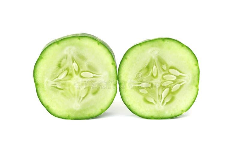 黄瓜两在白色的切片孤立 图库摄影
