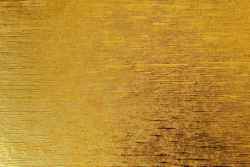 黄色叶子金箔织地不很细背景适用于任何设计 免版税库存图片