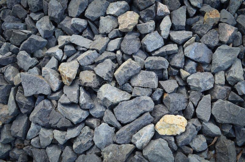 黄色和灰色岩石 背景雨岩石纹理 结构背景详细资料门面石头纹理 免版税库存图片