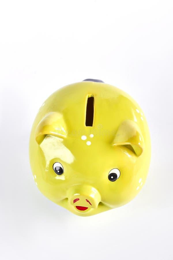 黄色存钱罐,顶视图 免版税库存照片