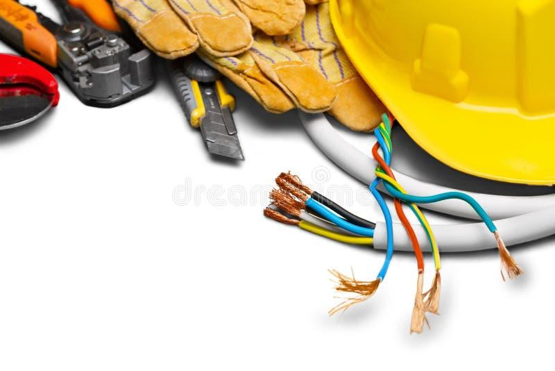 黄色安全帽和皮革工作手套 免版税库存照片