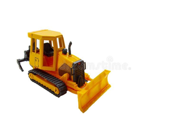 黄色履带牵引装置玩具拖拉机isolat 免版税库存图片
