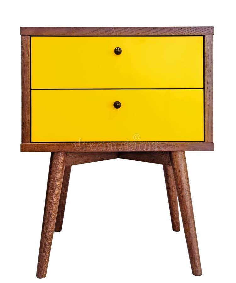 黄色木床头柜 在白色背景正面图隔绝的现代设计师nightstand 有两个抽屉的内阁 库存图片