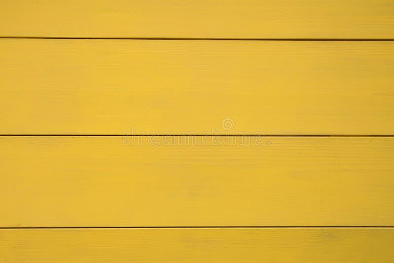 黄色木纹理,木板,水平的条纹篱芭  库存图片