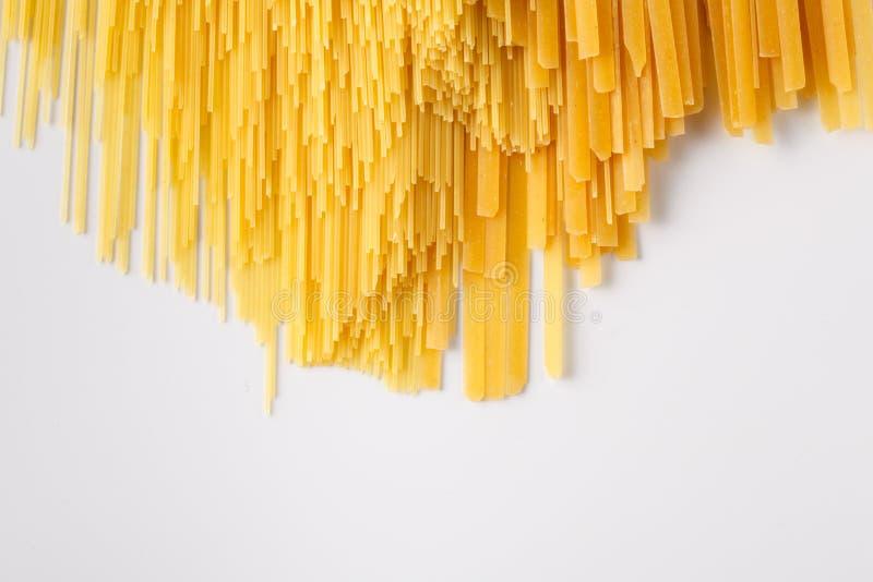 黄色未加工的面团背景的照片 免版税库存图片