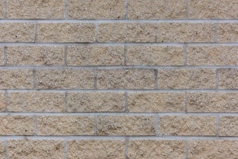 黄色概略的砖墙背景 库存例证