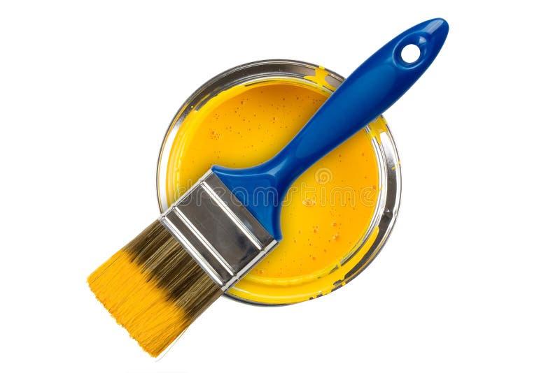 黄色油漆罐头 免版税库存照片