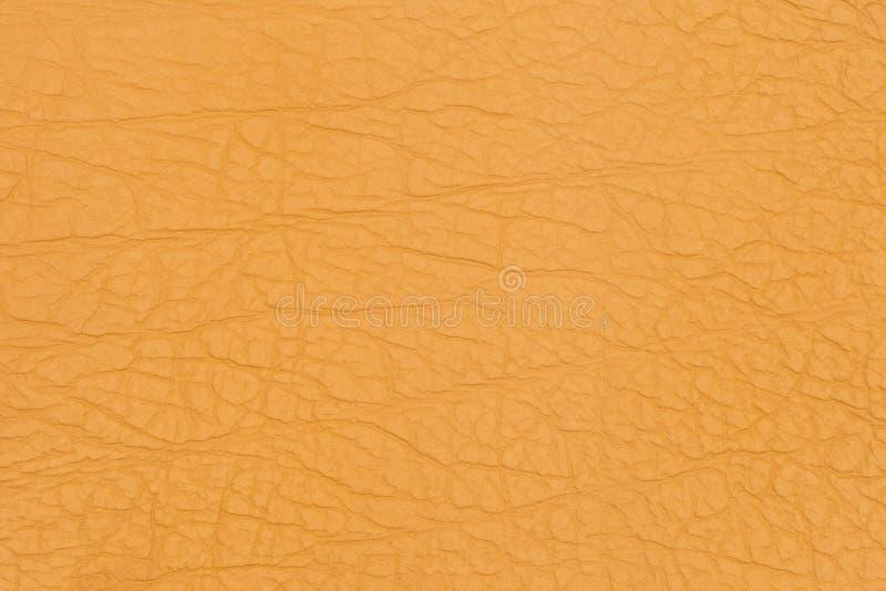 黄色皮革纹理背景 免版税图库摄影