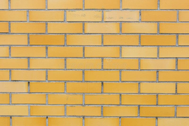 黄色砖墙背景纹理 免版税图库摄影