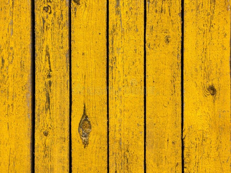 黄色色的老木板条纹理背景 库存照片