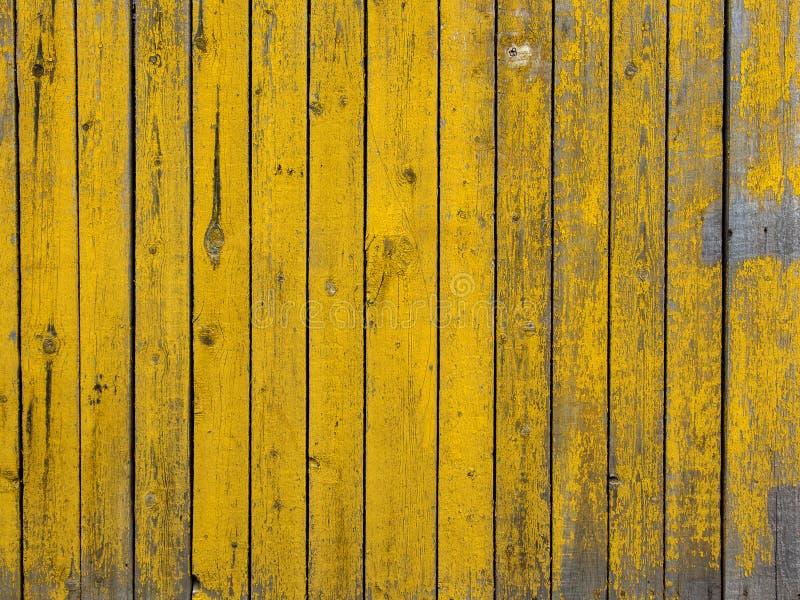 黄色色的老木板条纹理背景 图库摄影
