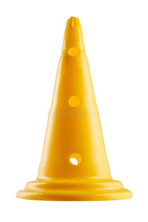 黄色高交通锥体在白色背景站立,制约运动 库存照片