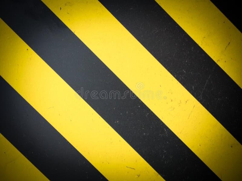 黄色黑镶边危险警告背景 免版税库存照片