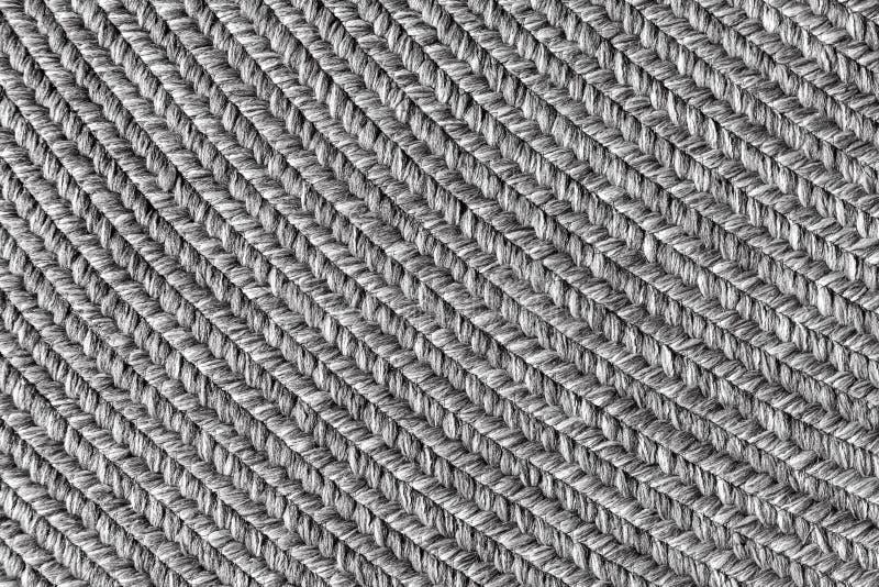 黄麻结辨的家庭螺旋地毯背景 库存照片