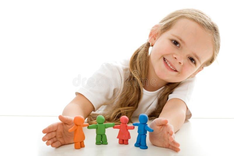 黏土色的小雕象女孩一点 库存图片
