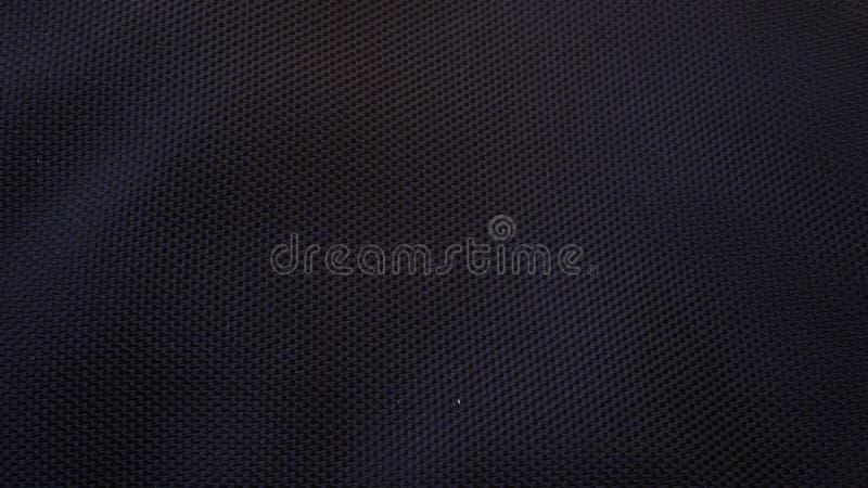 黑丝绸缎纹理,黑棉织物背景 图库摄影