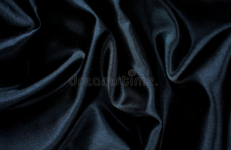黑丝绸背景纹理材料空白的秀丽 库存图片