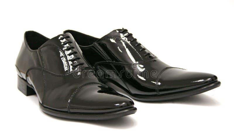 黑人发光的鞋子 免版税库存照片