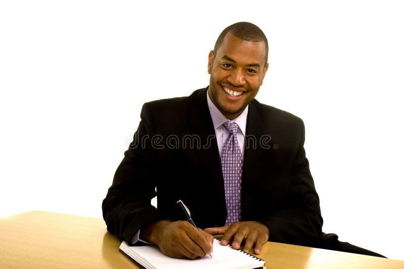 黑人服务台人微笑的文字 图库摄影