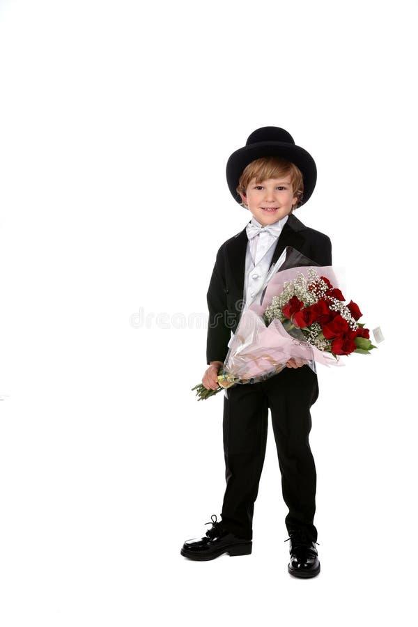 黑人男孩逗人喜爱的无尾礼服 图库摄影