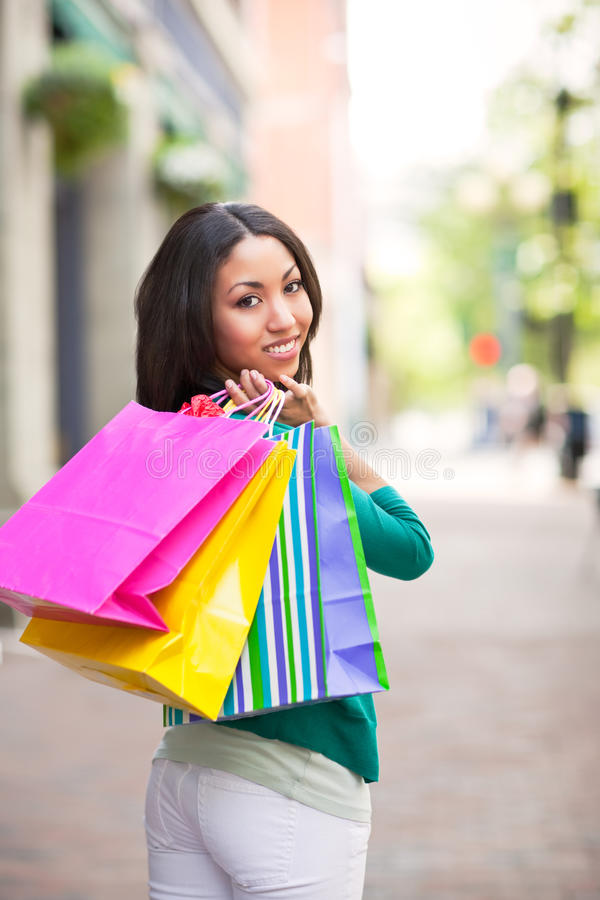 黑人购物妇女 库存照片