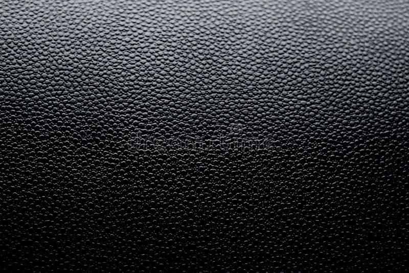黑假皮革表面 库存图片