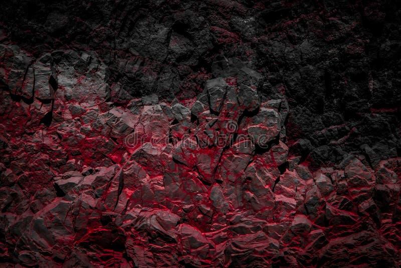 黑和红色上色了岩石/岩石墙壁背景 免版税库存照片