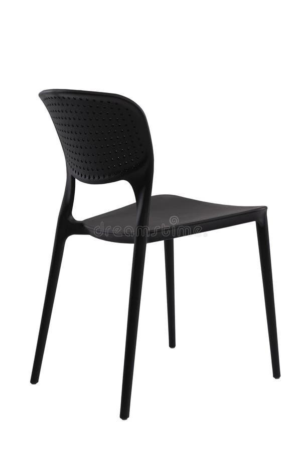 黑塑料室外椅子,后面看法 咖啡馆或家庭家具 免版税库存照片