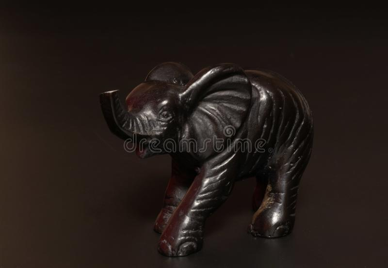 黑大象小雕象 库存图片