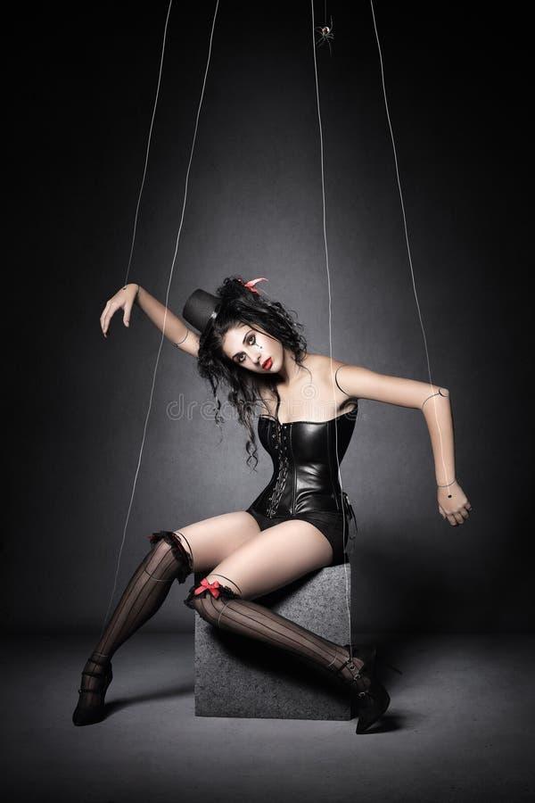 黑寡妇牵线木偶木偶 库存图片