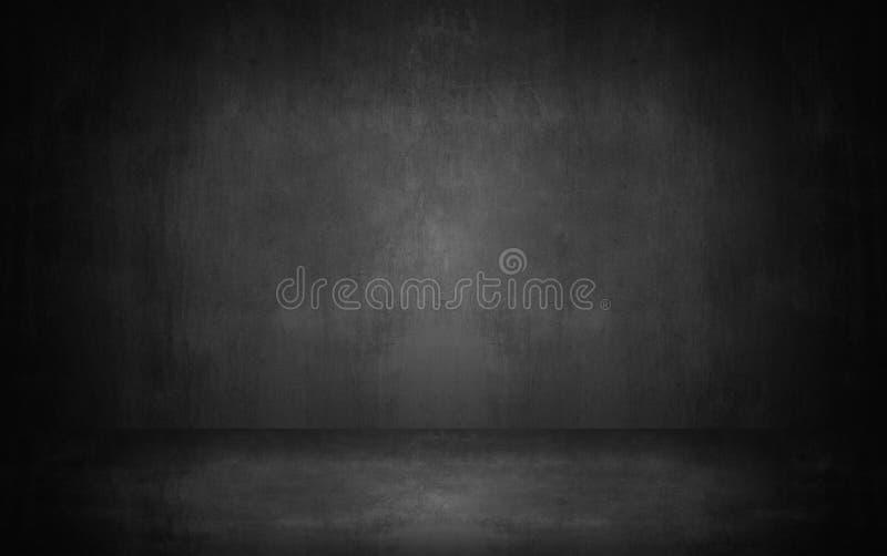 黑暗和灰色抽象水泥墙壁和演播室室梯度bac 免版税库存图片