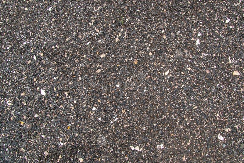 黑暗的中立颜色织地不很细小卵石  库存照片