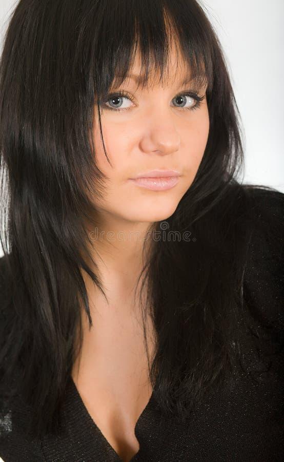 黑暗的女孩头发的纵向 免版税库存图片