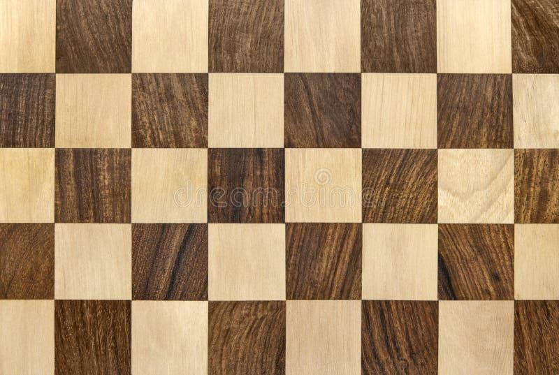 黑暗的木棋枰方格的背景 库存照片