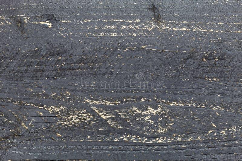 黑暗的木纹理背景,黑老盘区木板条 图库摄影